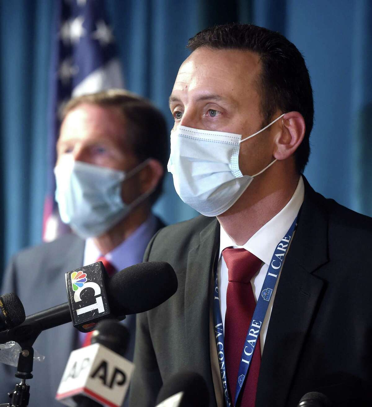 U.S. Senator Richard Blumenthal (left) listens to Alfred Montoya, Jr., medical director of the VA Connecticut Healthcare System, speak at a press conference following an explosion at the boiler plant at the West Haven VA Hospital that took two lives on November 13, 2020.