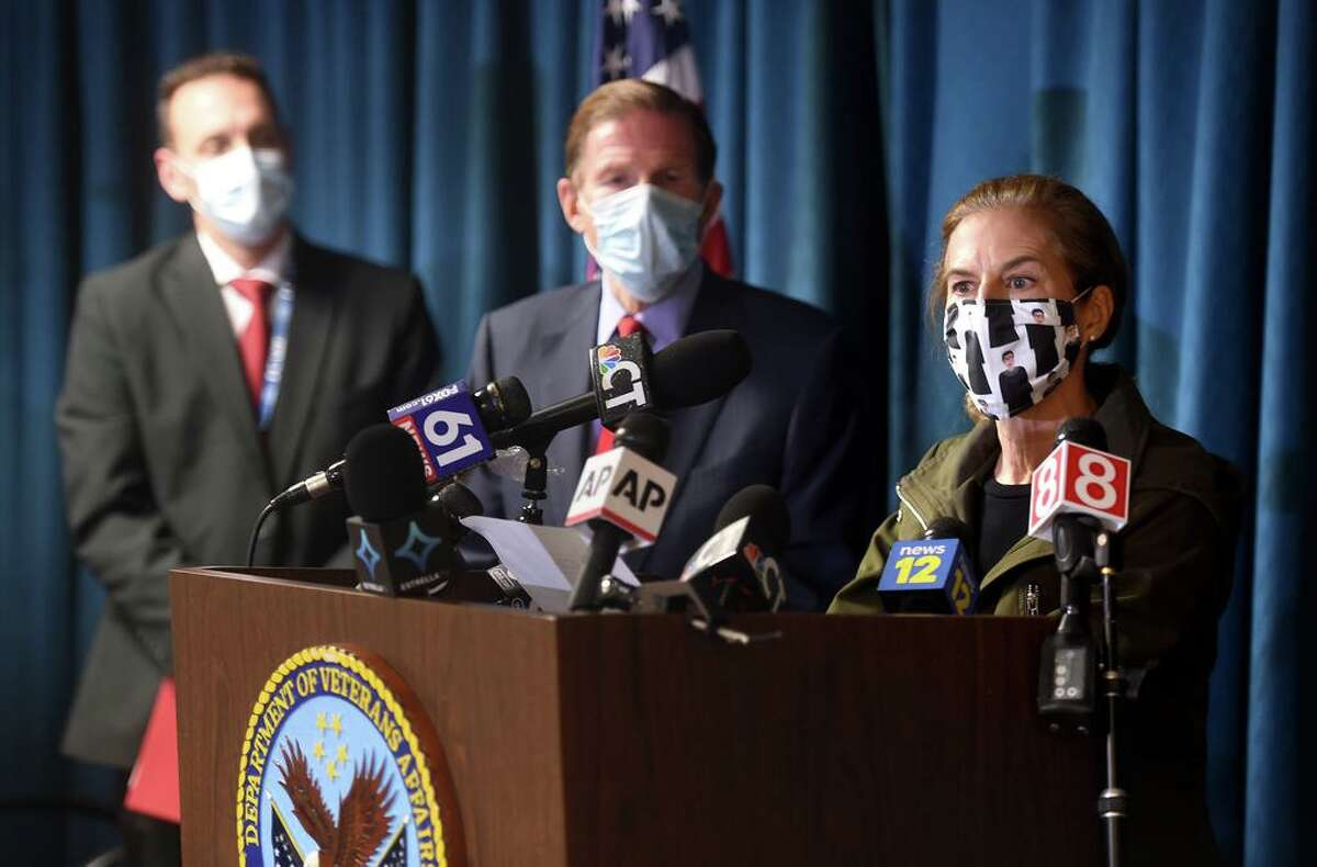 From left, Alfred Montoya, Jr., medical director of the VA Connecticut Healthcare System, and U.S. Sen. Richard Blumenthal listen to Lt. Gov. Susan Bysiewicz speak at a press conference following an explosion at the boiler plant at the West Haven Veterans Affairs medical center campus that took two lives Nov. 13, 2020.