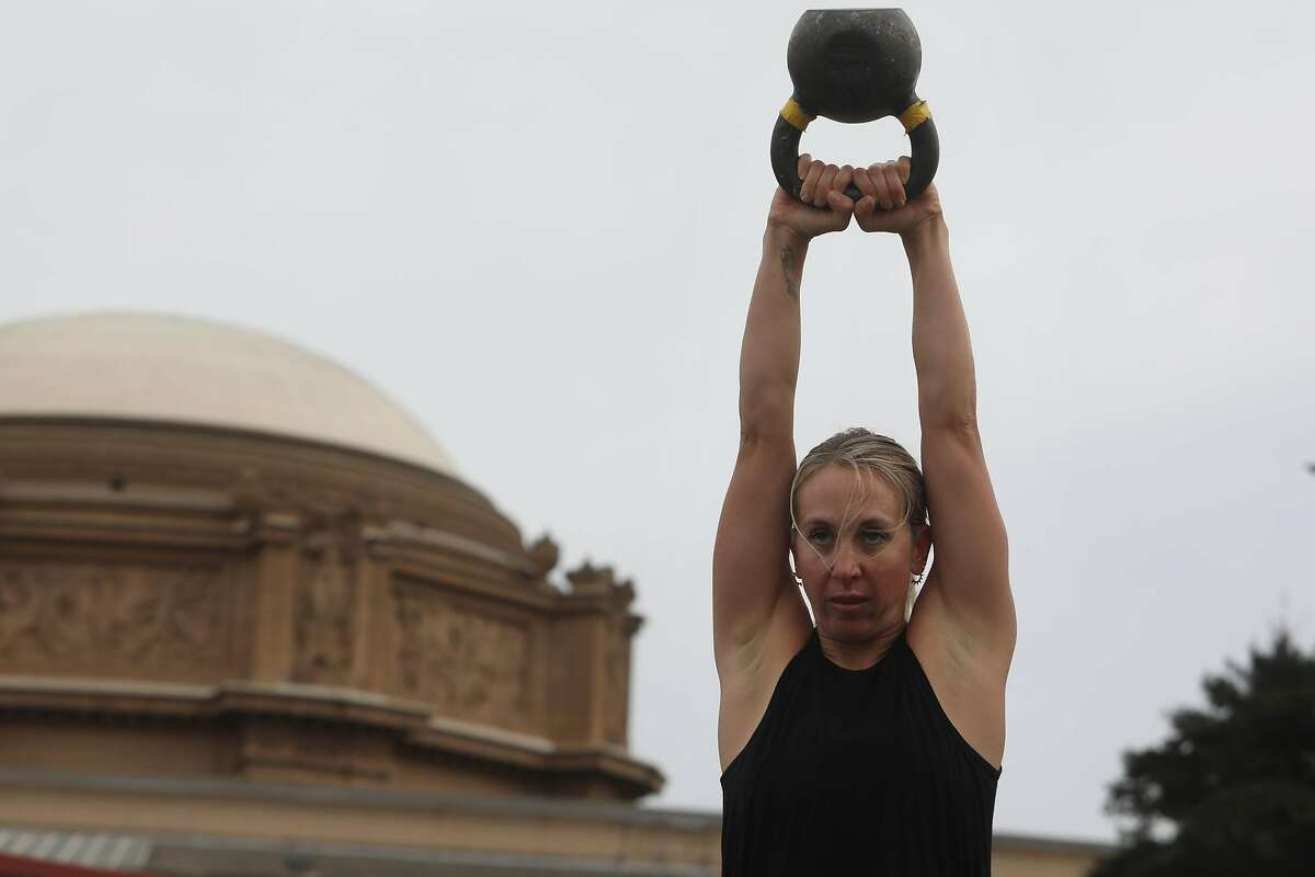 Laura Pennington of San Francisco uses a kettlebell at San Francisco CrossFit. The business started in the parking lot of Sports Basement in the Presidio.