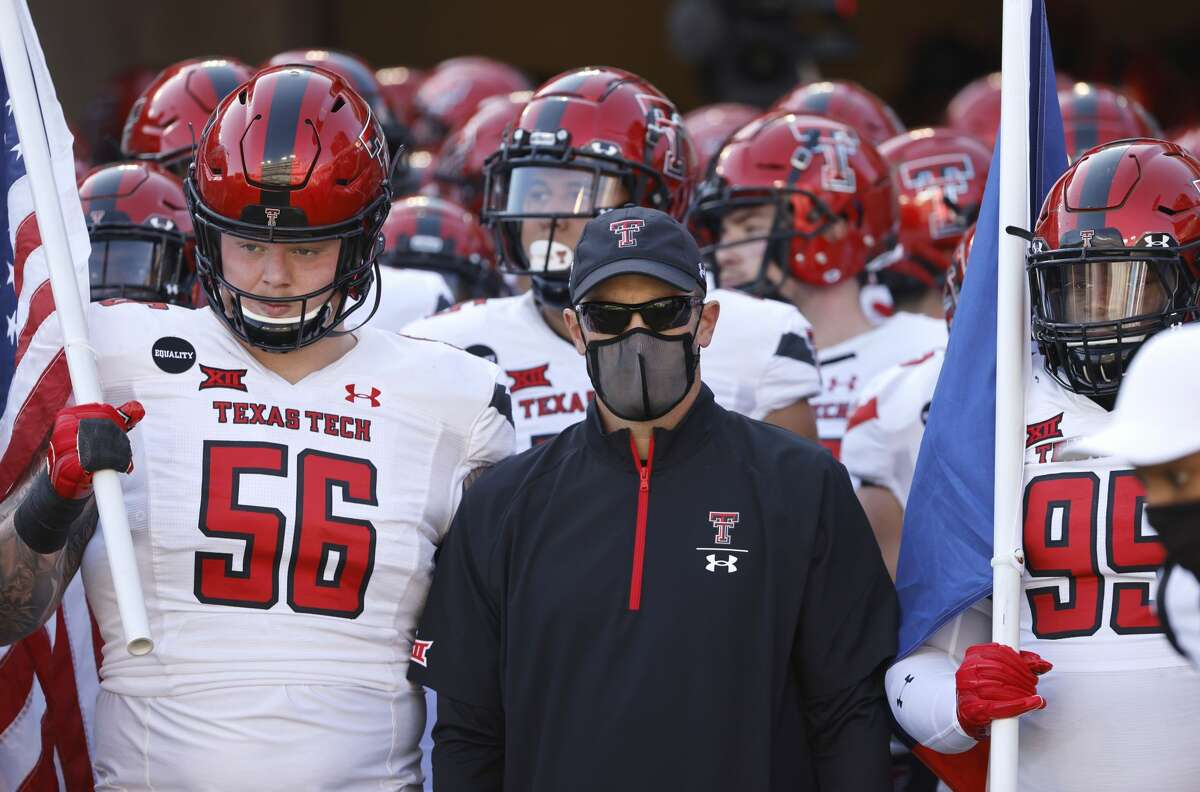 Texas Tech head coach Matt Wells and his team including Texas Tech offensive lineman Jack Anderson (56) and Texas Tech defensive lineman Jaylon Hutchings (95) wait before playing TCU in an NCAA college football game Saturday, Nov. 7, 2020, in Fort Worth. (AP Photo/Ron Jenkins)