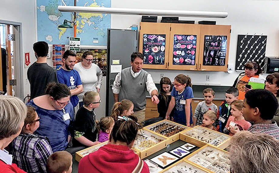 Young Explorers Club members get a closer look at insect display cases during a meeting this past winter. The club, a youth division of the Morgan County Audubon Society, takes a hands-on approach to science and nature. Photo: Photo Provided