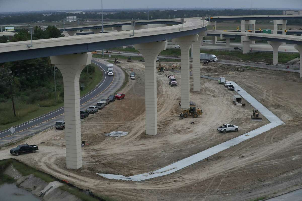A view looking north from the ramp from the new southbound Texas 288 toll lanes to the eastbound Sam Houston Tollway, seen Nov. 13 in Houston. Crews continue work on stormwater detention ponds in the interchange.
