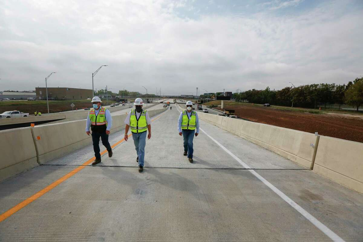 Sean Lind, left, Rick Liesse and Sam Sauceda walk up the entrance ramp from Holcombe to the new southbound Texas 288 toll lanes on Nov. 13 in Houston. The toll lanes open Nov. 16.