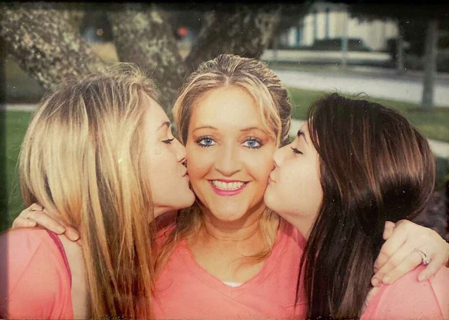 Traci Carey, center, died from injuries suffered in a Nov. 5 car accident. Her daughter, Nikki, 22, is at left, and Tarrah, 21 at right. Photo: Used With Permission Of Terri Zollinger /