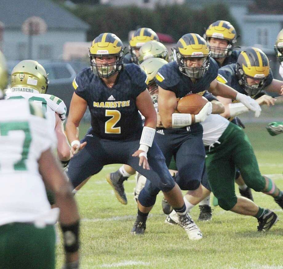 Manistee seniors Brady Mikula (left) and Laden Powers (right) were first-team selections on the all-Lakes 8 Conference list this season, Brady as a defensive lineman and Powers as an offensive skills position. (News Advocate file photo)