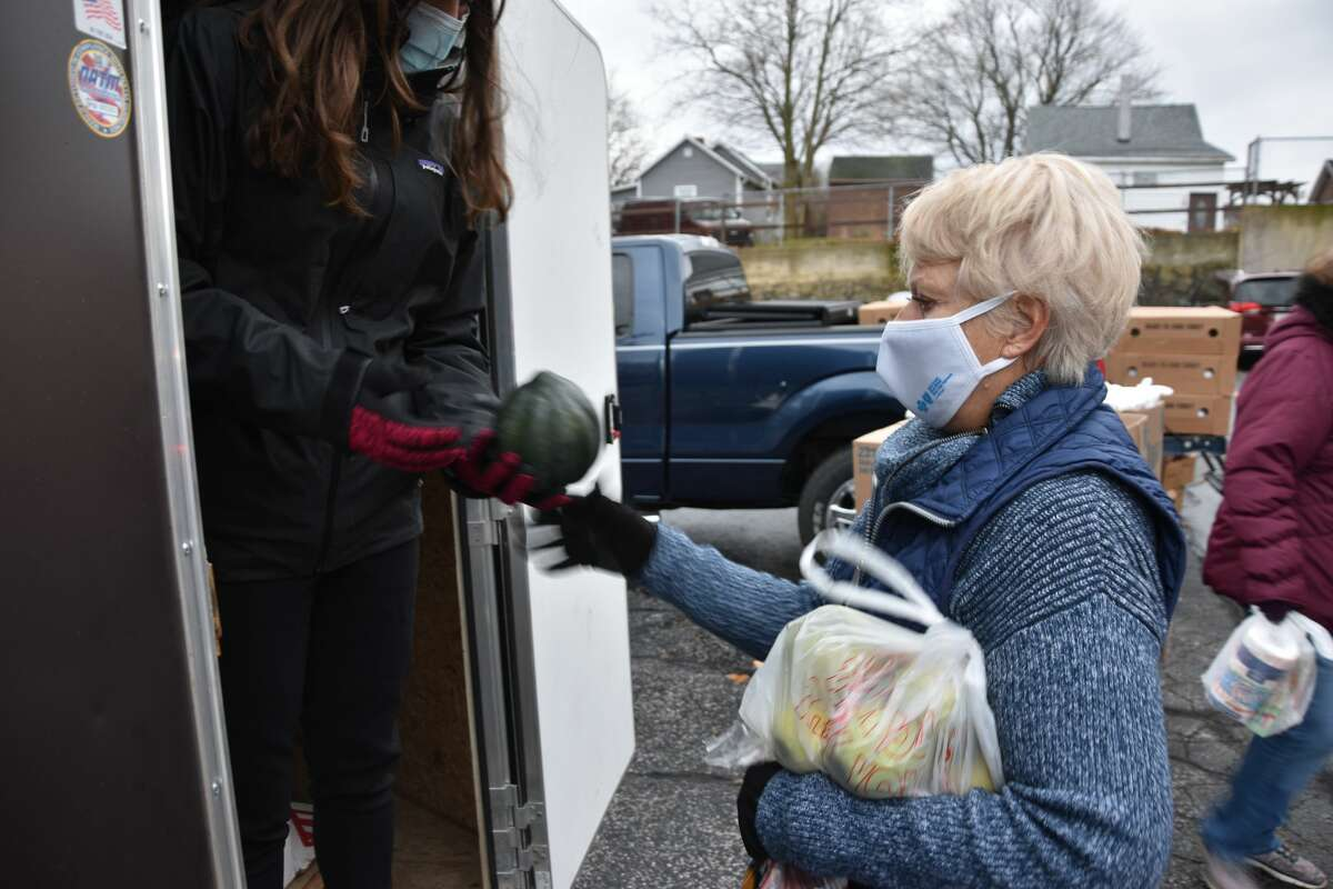 Even though it was a bitter, blustery 33-degree day, volunteers quickly loaded vehicles for 148 individuals or families during the drive-thru Matthew 25:35 food pantry on Friday morning.