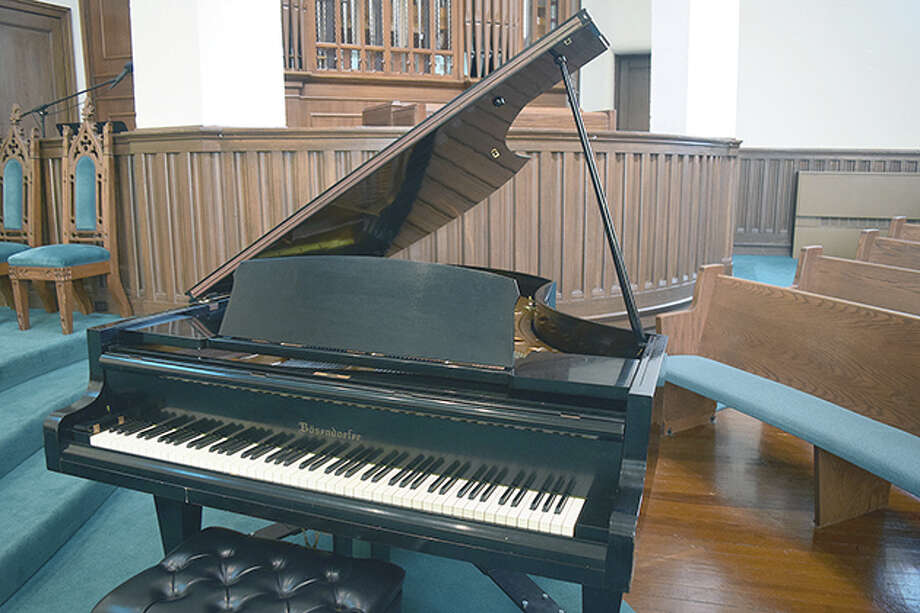 First Presbyterian Church bought a Bosendorfer grand piano from MacMurray College. The church will use the piano for services starting Nov. 22. Photo: Marco Cartolano | Journal-Courier
