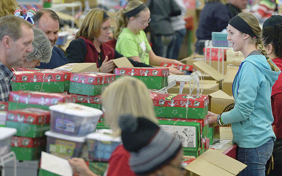 Volunteers fill shoeboxes with toys and school supplies to be distributed to children around the world through Samaritan's Purse and Operation Christmas Child. Volunteers will work for weeks leading up to the holiday to prepare the boxes for shipment. Photo: Kathryn Scott Osler | Getty Images  / Copyright - 2015 The Denver Post, MediaNews Group.