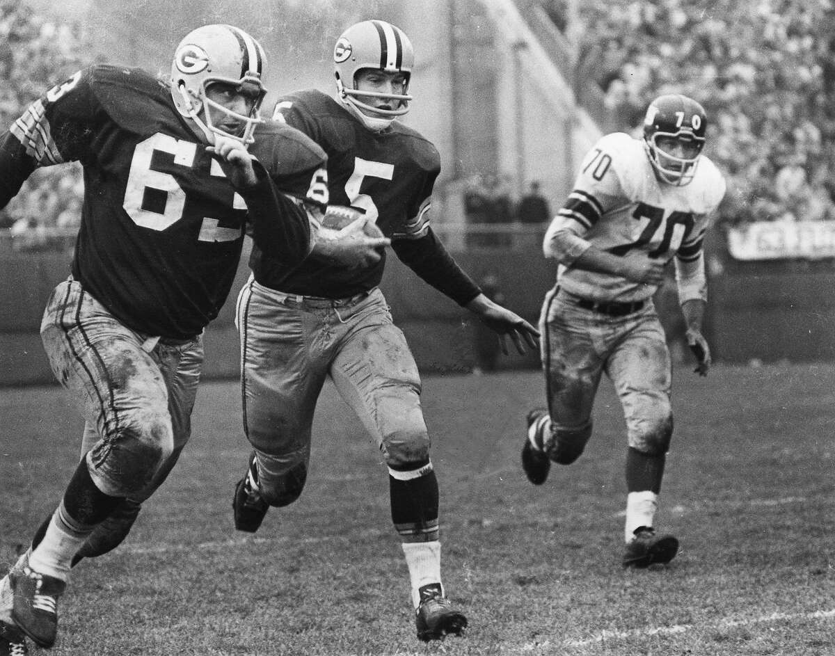 Green Bay's Paul Hornung (5) and Fuzzy Thurston (63) in 1961.