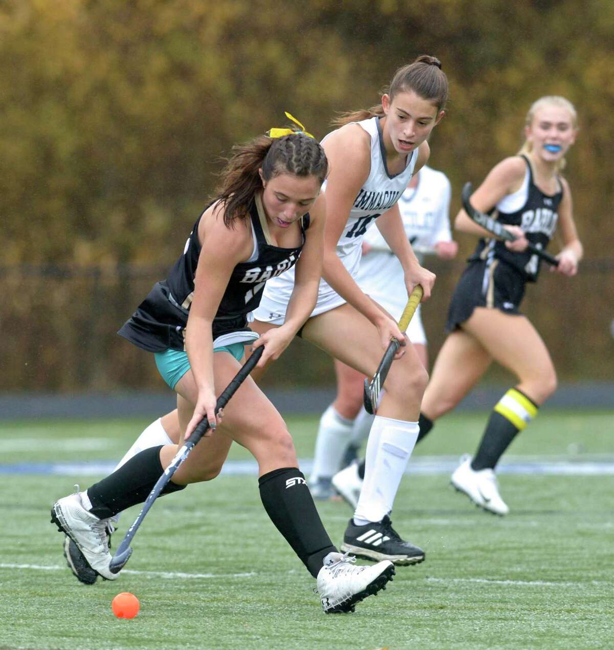 Joel Barlow's Marin Kalamaras (12) moves the ball out of the reach of Immaculate's Sadie Jarboe (10) in the girls SWC Field Hockey South championship game between No. 3 Joel Barlow and No. 1 Immaculate high schools, Friday afternoon, November 13, 2020 at Immaculate High School, Danbury, Conn.