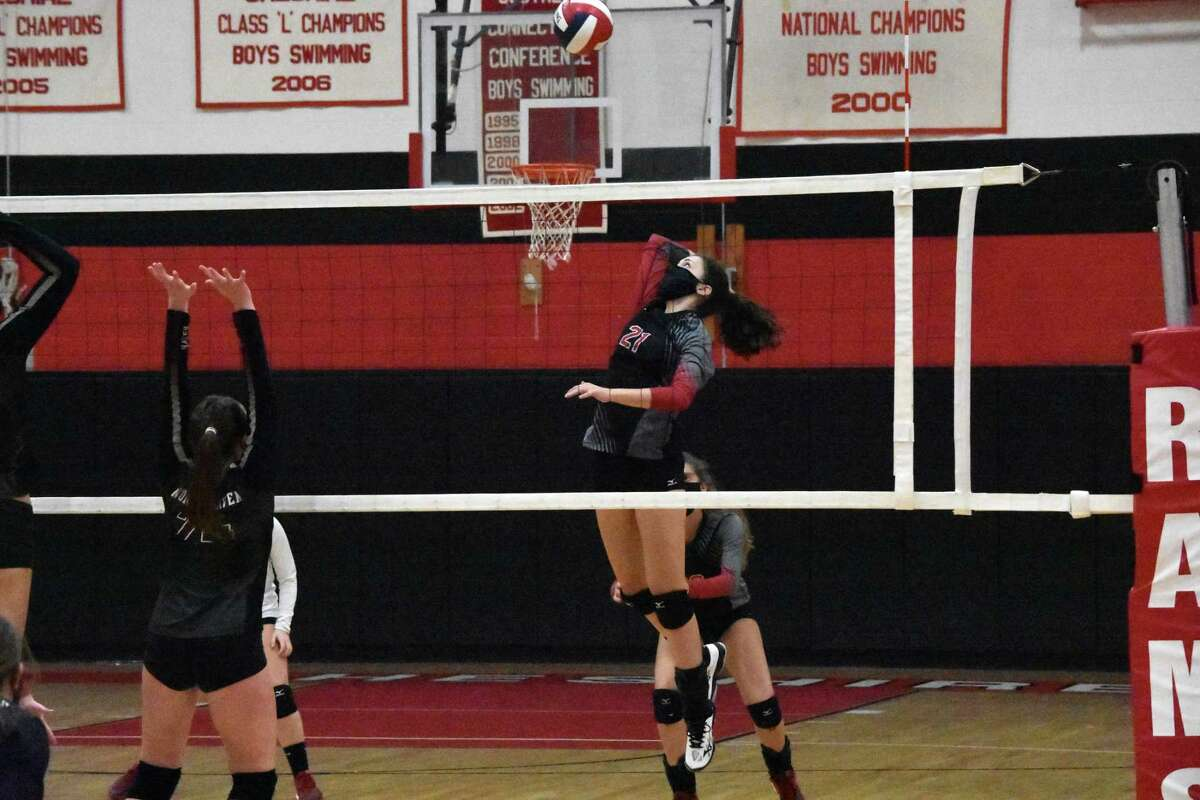 Cheshire's Avery Mola spikes the ball in the SCC Division B final against North Haven on Friday.