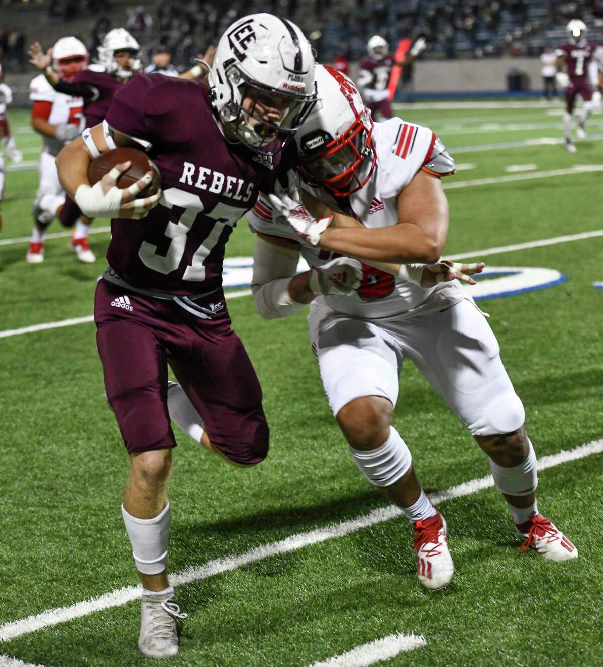Lee's Brant Stalder (37) is pushed out of bounds by Odessa High's Perry Gonzales after catching an interception Friday, Nov. 13, 2020 at Grande Communications Stadium. Jacy Lewis/Reporter-Telegram