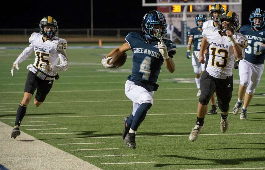 Greenwood's Trey Cross races down the sideline on the way to a touchdown as Seminole's Cy Cramer, 15, and Sloan Rowland, 13, chase after him 11/13/2020 at J.M. King Memorial Stadium. Tim Fischer/Reporter-Telegram Photo: Tim Fischer, Midland Reporter-Telegram