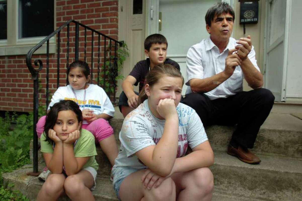 Aferdita, 6, and Dorontina, 13 (both seated front), and Dorisa, 10, and Dorart, 11, (both seated behind), sit with their uncle Skender on the front steps of the Emini home, in Naugatuck, Conn. Thursday, June 17th, 2010.