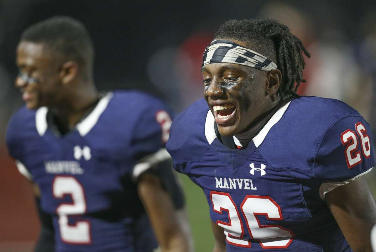 Manvel's Ben Wilson (26) wears the number his uncle Kevin Smith donned for Texas A&M and the Dallas Cowboys. He'd also like to follow the path of his father Robert, a former Texas A&M and NFL player, and Smith into the collegiate ranks as signing day nears.