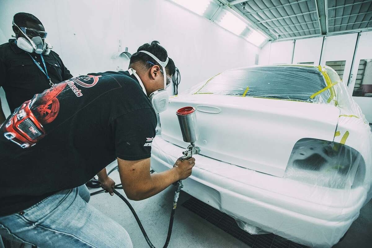 Shown here is a Houston Community College auto body student in training with instructor.