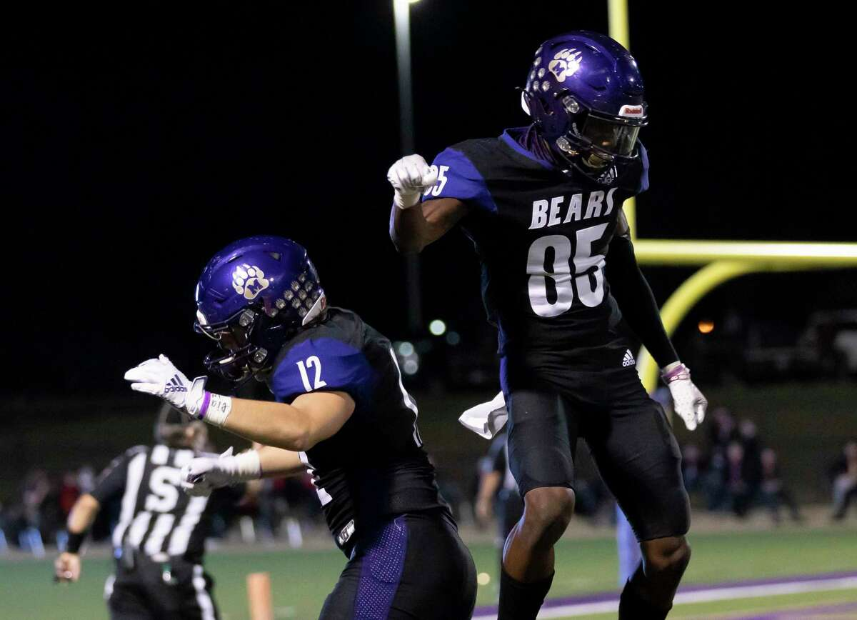Montgomery wide receiver Tre Harden (85) and defensive end Chase Kalosis (12) celebrate during the second quarter of a District 10-5A (Div. II) football game at Montgomery ISD Stadium on Friday, Nov. 13, 2020.