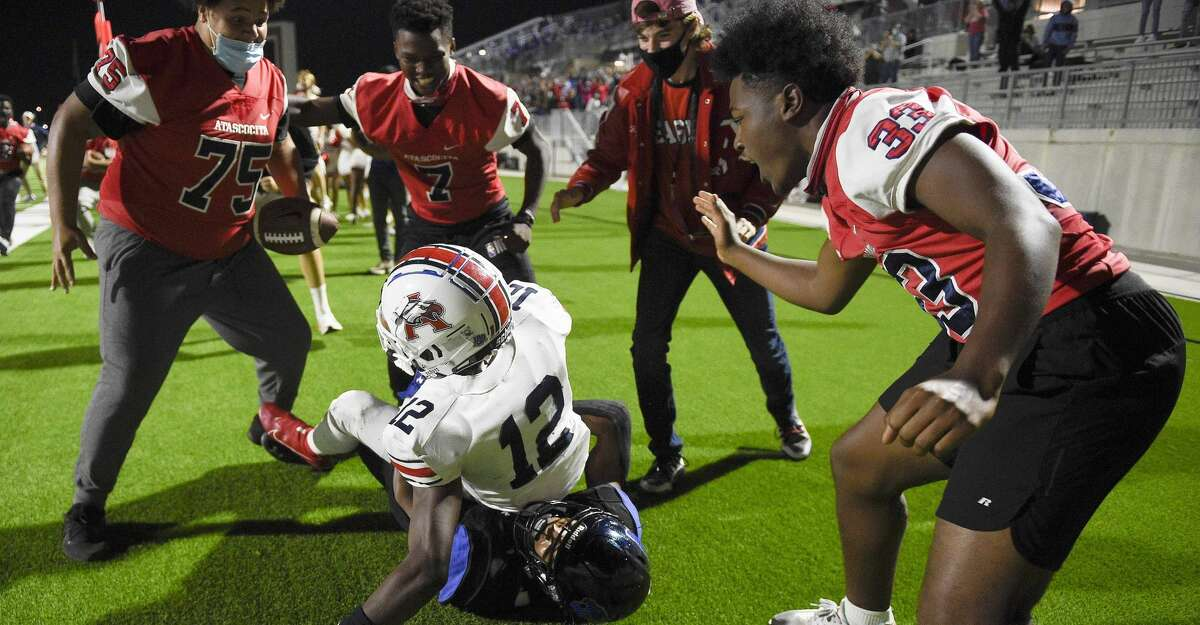 Atascocita ballboys celebrate Atascocita wide receiver Keith Wheeler's (12) go-ahead and eventual game-winning touchdown during the second half of a high school football game against CE King, Friday, Nov. 13, 2020, in Houston.