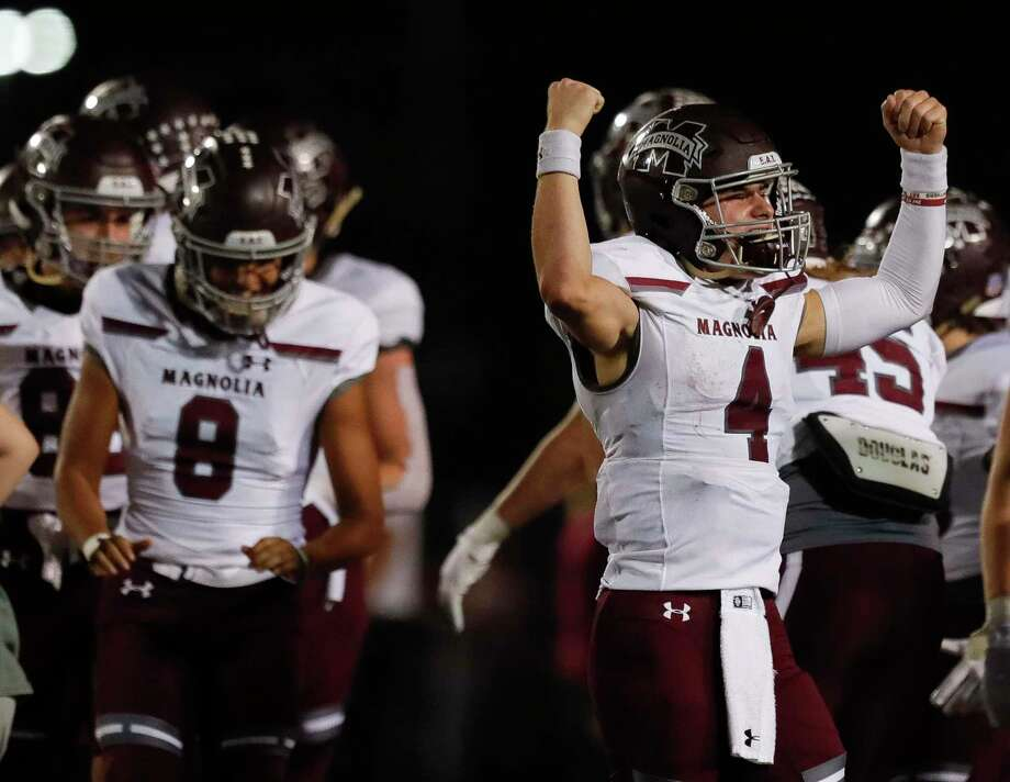 Magnolia quarterback Travis Moore (4) reacts after the Bulldogs defeated rival Magnolia West 21-14 during the third quarter of a District 8-5A high school football game at Magnolia West High School, Friday, Nov. 13, 2020, in Magnolia. Photo: Jason Fochtman, Houston Chronicle / Staff Photographer / 2020 © Houston Chronicle