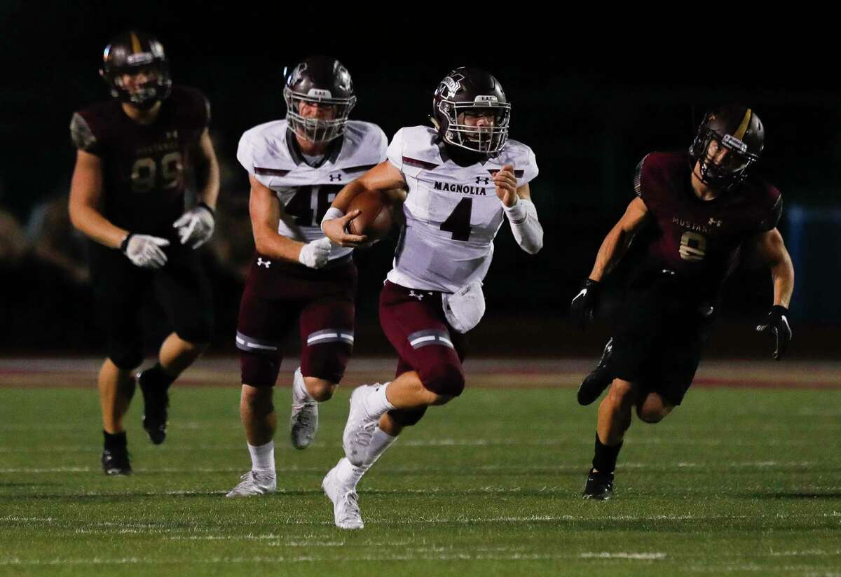 Magnolia quarterback Travis Moore (4) runs for a 40-yard gain during the second quarter of a District 8-5A high school football game at Magnolia West High School, Friday, Nov. 13, 2020, in Magnolia.