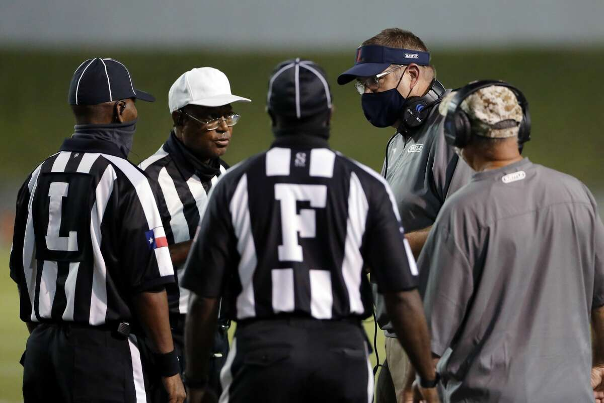 Lamar Texans head coach Michael Lindsey talks with officials during the first half of a high school football game against the Heights Bulldogs at Delmar Stadium Friday, Nov. 13, 2020 in Houston, TX.