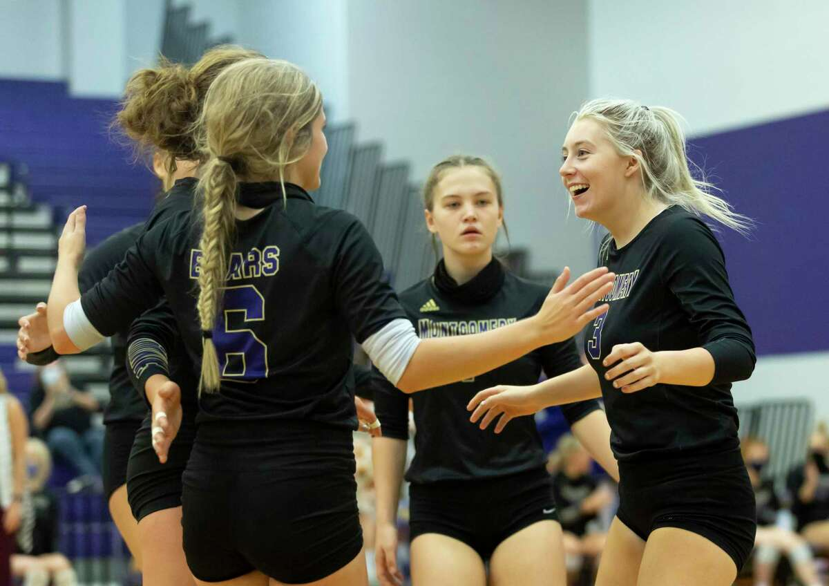 FILE PHOTO - Montgomery defensive specialist Peyton Siegrist (3) reacts with her teammates after they win third set of a District 20-5A volleyball match against Porter at Montgomery High School on Tuesday, Nov. 10, 2020.