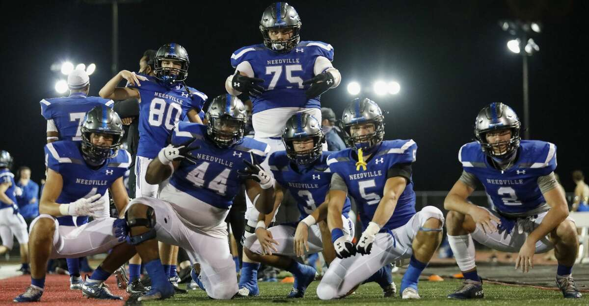 The Needville Bluejays celebrate after a turnover during the second half of the high school playoff football game between the Needville Bluejays and the Furr Brahmans at Stafford MSD Stadium in Stafford, TX on Friday, November 13, 2020. The Bluejays defeated the Brahmans 51-13. Pictured from left are Tannor Baker (4), Pedro Cavazos (80), Bryant Jones (44), Blake Boenisch (75), Cole Todd (3), Walker Warncke (5), and Dax Bridges (2).