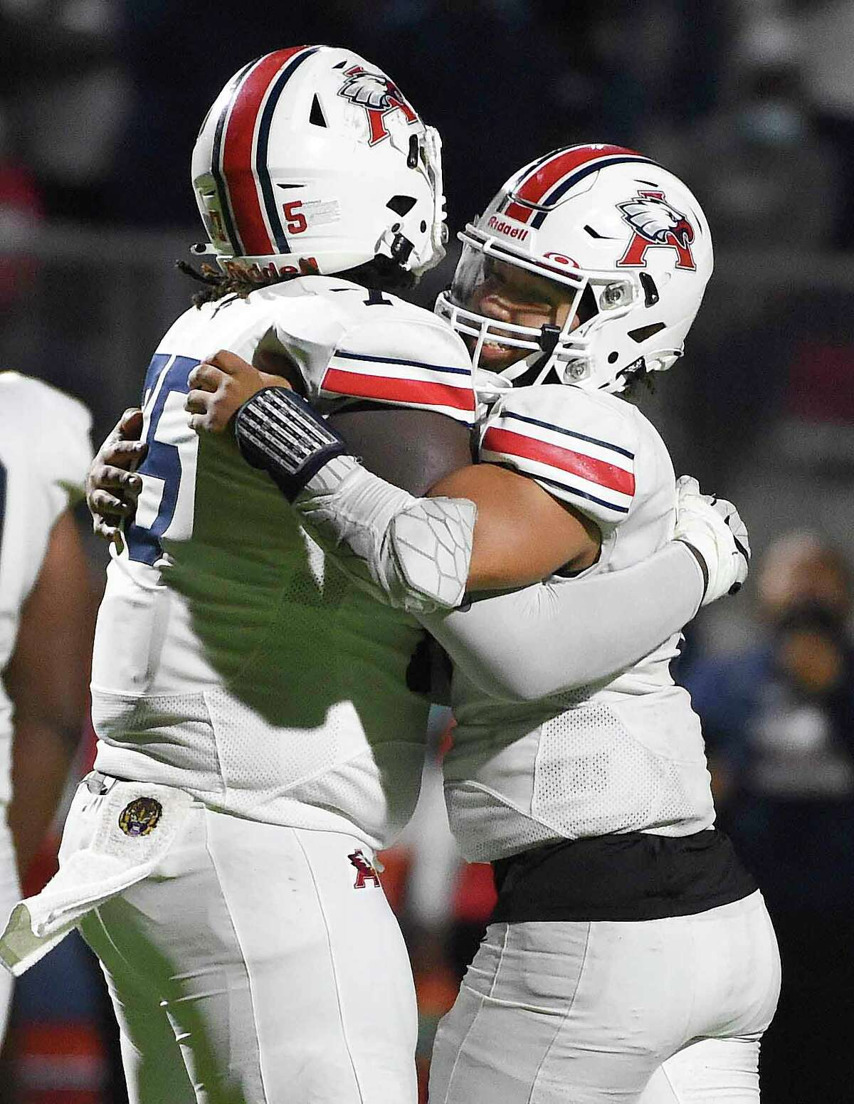 Atascocita quarterback Gavin Session, right, celebrates the team's win with Kameron Dewberry after a high school football game against CE King, Friday, Nov. 13, 2020, in Houston.