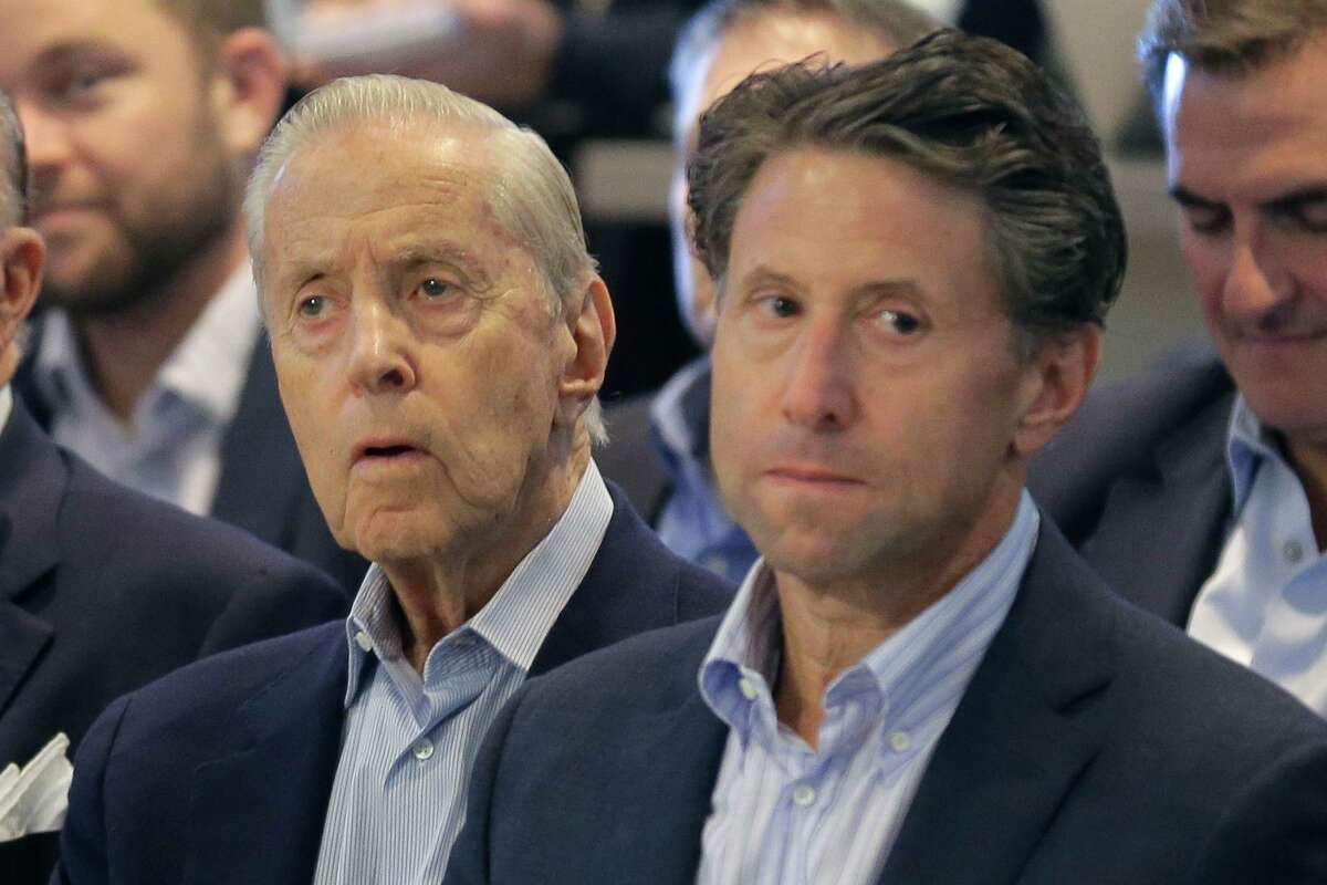 FILE - In this Nov. 4, 2019, file photo, New York Mets owners Fred, left, and Jeff Wilpon attend a baseball news conference at Citi Field in New York. Major League Baseball owners voted Friday, Oct. 30, 2020, to approve the sale of the New York Mets to billionaire hedge fund manager Steve Cohen. The sale from the Wilpon and Katz families values the franchise at between $2.4 billion and $2.45 billion, a record for a baseball team. (AP Photo/Seth Wenig, File)