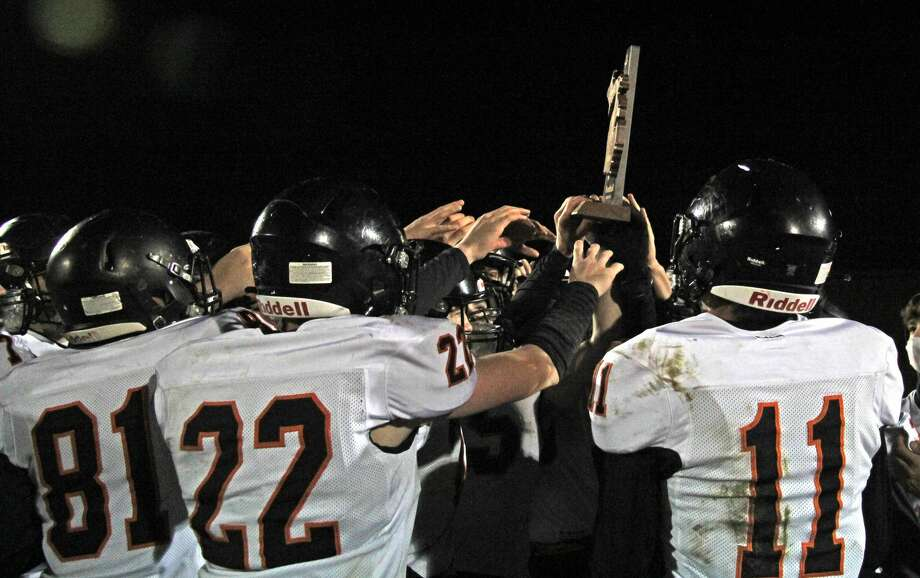 The Ubly varsity football team won its second straight district championship on Friday night with a 42-0 victory over Flint Beecher. Photo: Mark Birdsall/Huron Daily Tribune