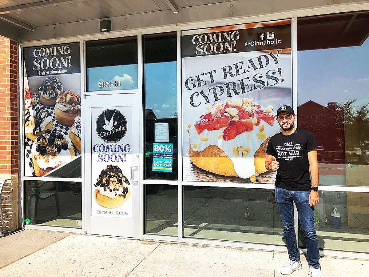 Héctor Figueroa stands outside the new Cypress Cinnaholic store located at 28290 Northwest Freeway, Ste. H-11 in Fairfield Town Center. The grand opening is set for Friday, Nov. 20 at 11 a.m.