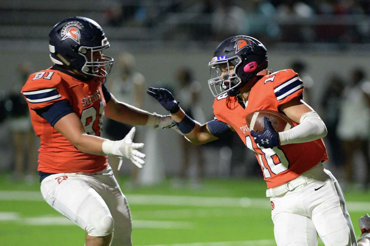 Beau Clewett (18) and Austin Thomas (81) of Seven Lakes react after a touchdown during the first half of a 19-6A football game between the Mayde Creek Rams and the Seven Lakes Spartans on Friday, November 13, 2020 at Legacy Stadium, Katy, TX.