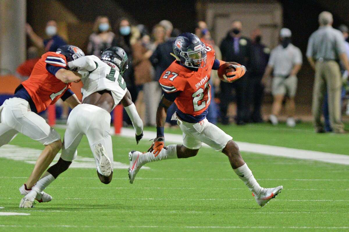 Milton Jones (27) of Seven Lakes carries the ball for a first down during the second half of a 19-6A football game between the Mayde Creek Rams and the Seven Lakes Spartans on Friday, November 13, 2020 at Legacy Stadium, Katy, TX.