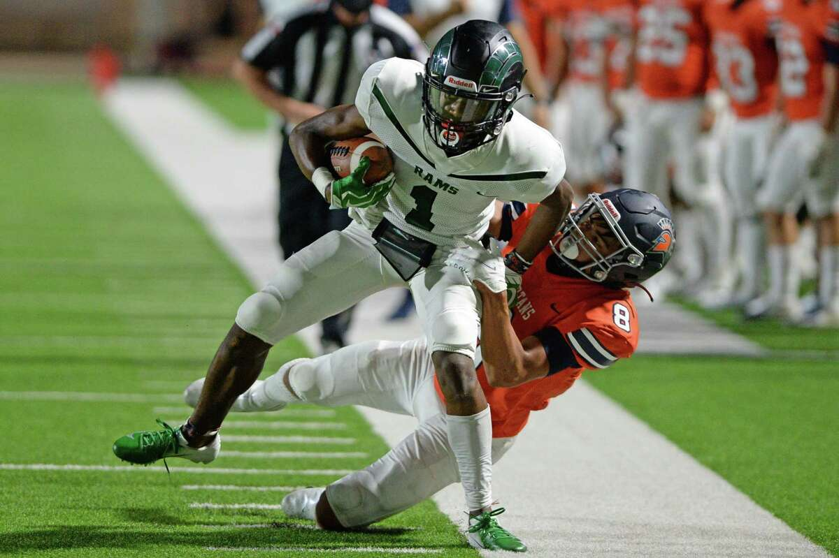 BJ Harrell (1) of Mayde Creek is forced out of bounds by Jonah Vela (8) of Seven Lakes following a first down reception during the first half of a 19-6A football game between the Mayde Creek Rams and the Seven Lakes Spartans on Friday, November 13, 2020 at Legacy Stadium, Katy, TX.