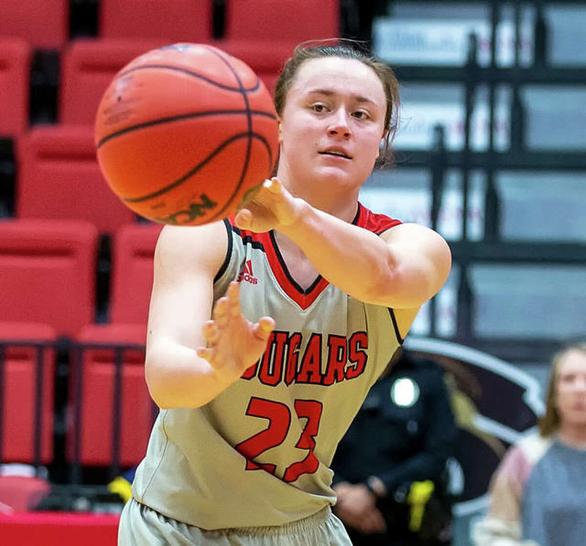 SIUE's Allie Troeckler passes to a teammate during a game last season at SIUE's First Community Arena in Edwardsville. Troeckler led the Cougars in scoring at 10.8 points per game as a junior.