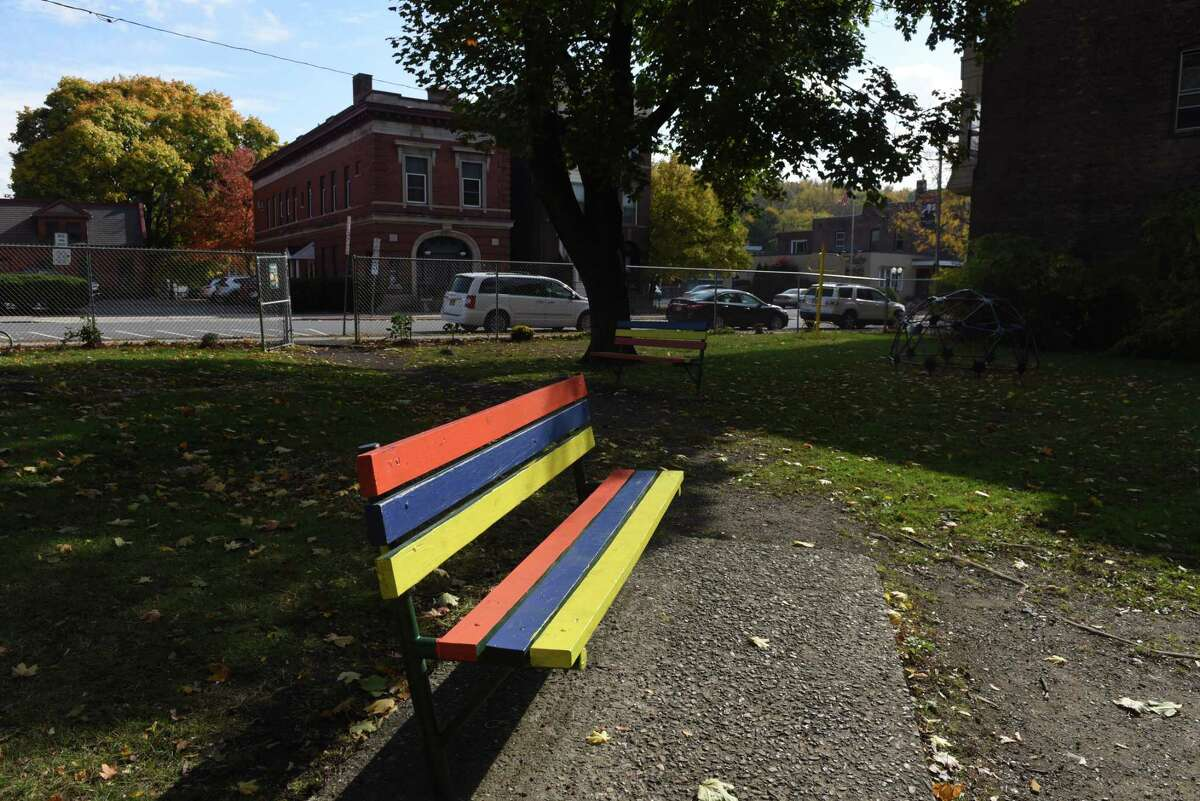 A park bench is repainted at the Osgood pocket park on Friday, Oct. 23, 2020, at Third Street and Canal Avenue in Troy, N.Y. Team HERO, a group of Black church leaders and community activist, has rebuilt the city pocket park opposite the Osgood Fire House. (Will Waldron/Times Union)