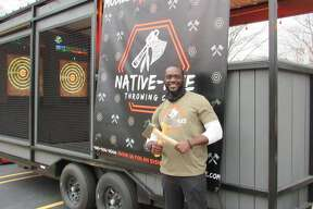 Native-Axe Throwing Co., owned by Ayo Akindona of Midland, set up in the parking lot of Live Oak Coffeehouse on Friday, Nov. 13.