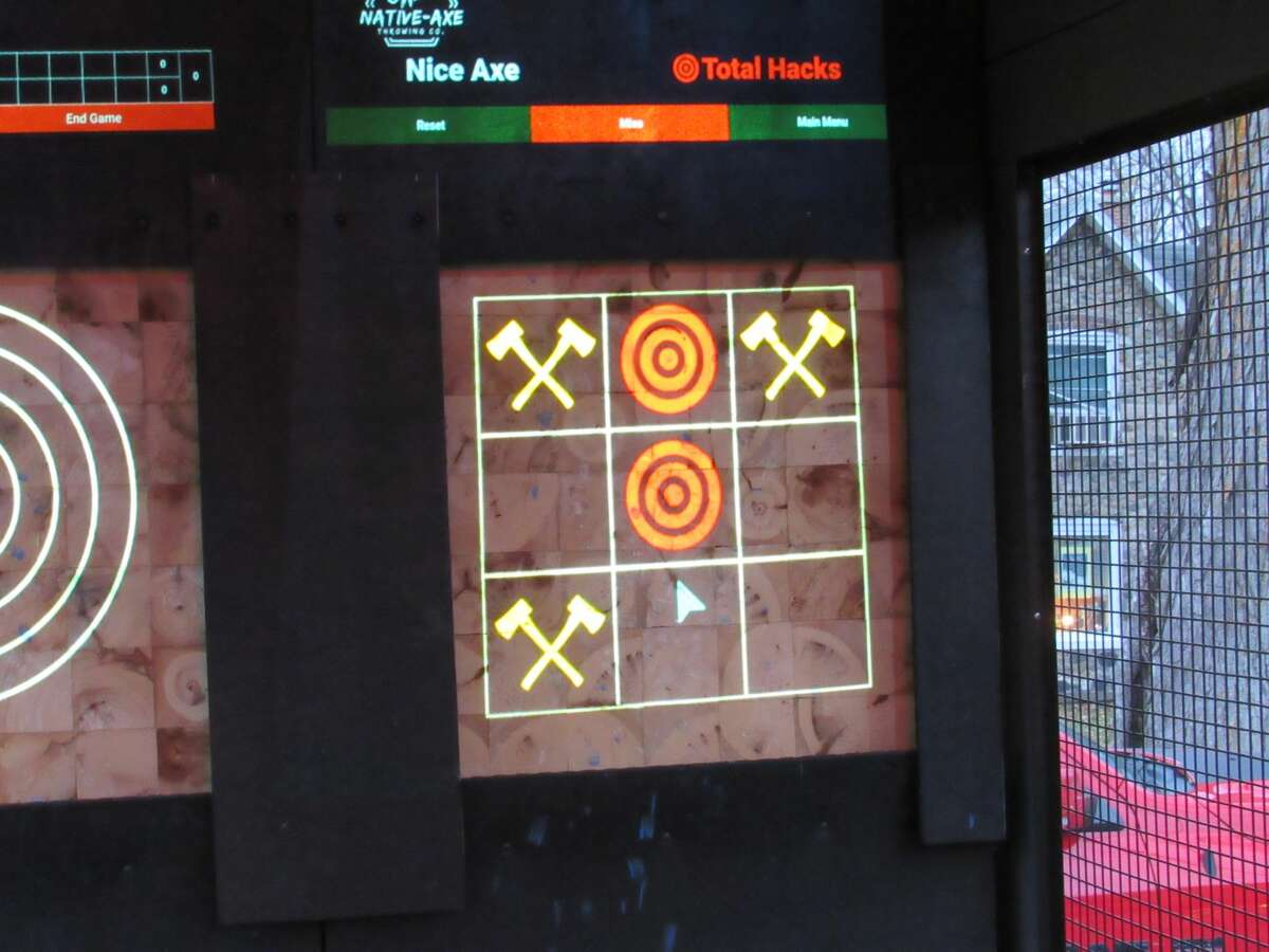 Native-Axe Throwing Co. offers varied games, including tic-tac-toe, all projected onto end grain boards.Native-Axe Throwing Co., owned by Ayo Akindona of Midland, set up in the parking lot of Live Oak Coffeehouse on Friday, Nov. 13.