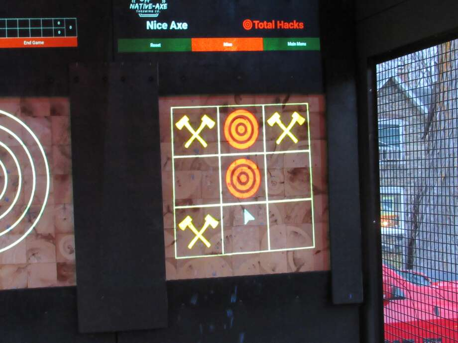 Native-Axe Throwing Co. offers varied games, including tic-tac-toe, all projected onto end grain boards.Native-Axe Throwing Co., owned by Ayo Akindona of Midland, set up in the parking lot of Live Oak Coffeehouse on Friday, Nov. 13. Photo: Victoria Ritter/vritter@mdn.net