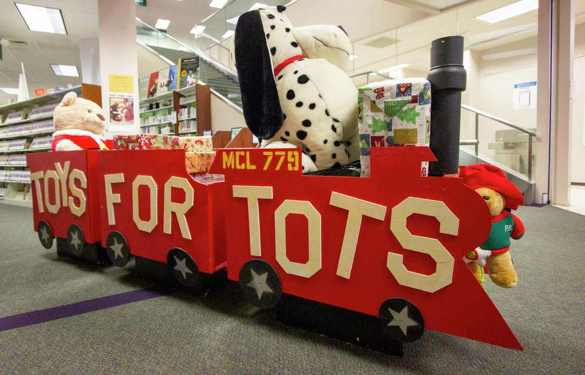 The Montgomery County Central Library staff and members of the United States Marine Corps Toys for Tots kick off their Toys for Tots campaign Wednesday, November 6, 2019 at Montgomery County Memorial Library System - Central Library in Conroe.