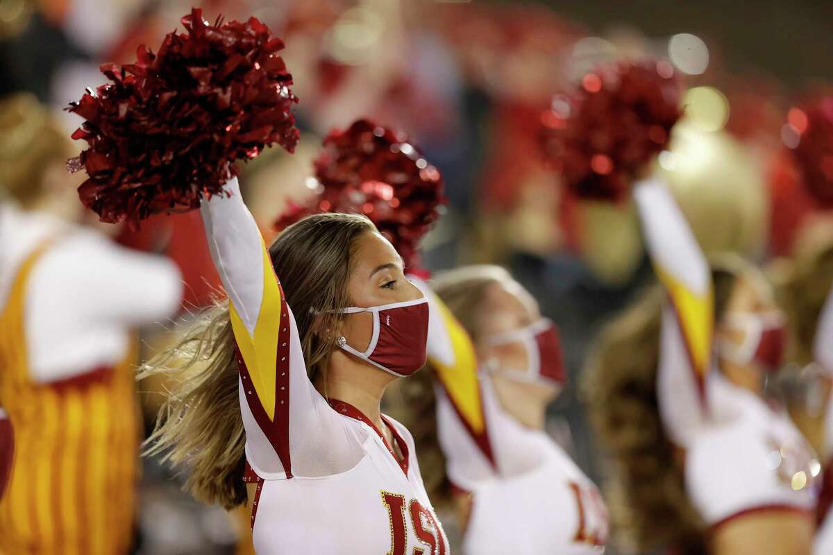 An Iowa State cheerleader performs with her mask on during the first half of an NCAA college football game against Baylor on Nov. 7.