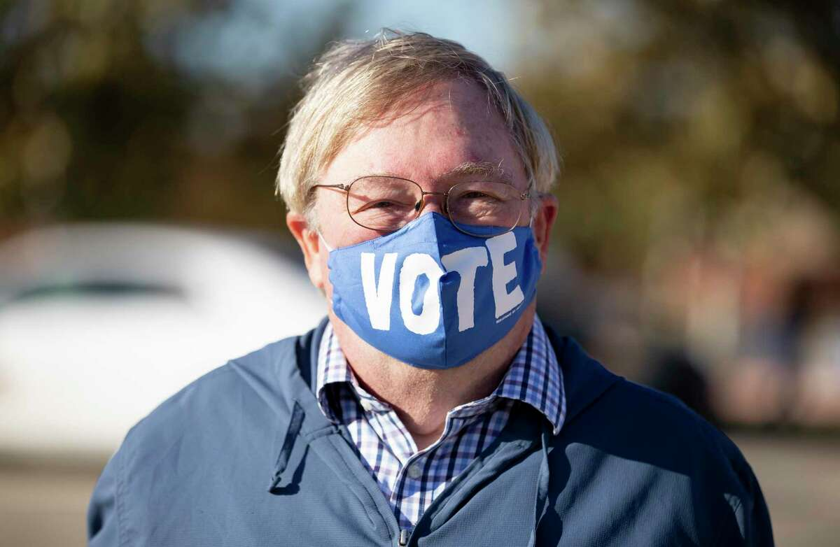 """Walt Foody wears a """"VOTE"""" mask as he campaigns at the Richard and Meg Weekely Community Center on Election Day, Tuesday, Nov. 3, 2020, in Cypress."""
