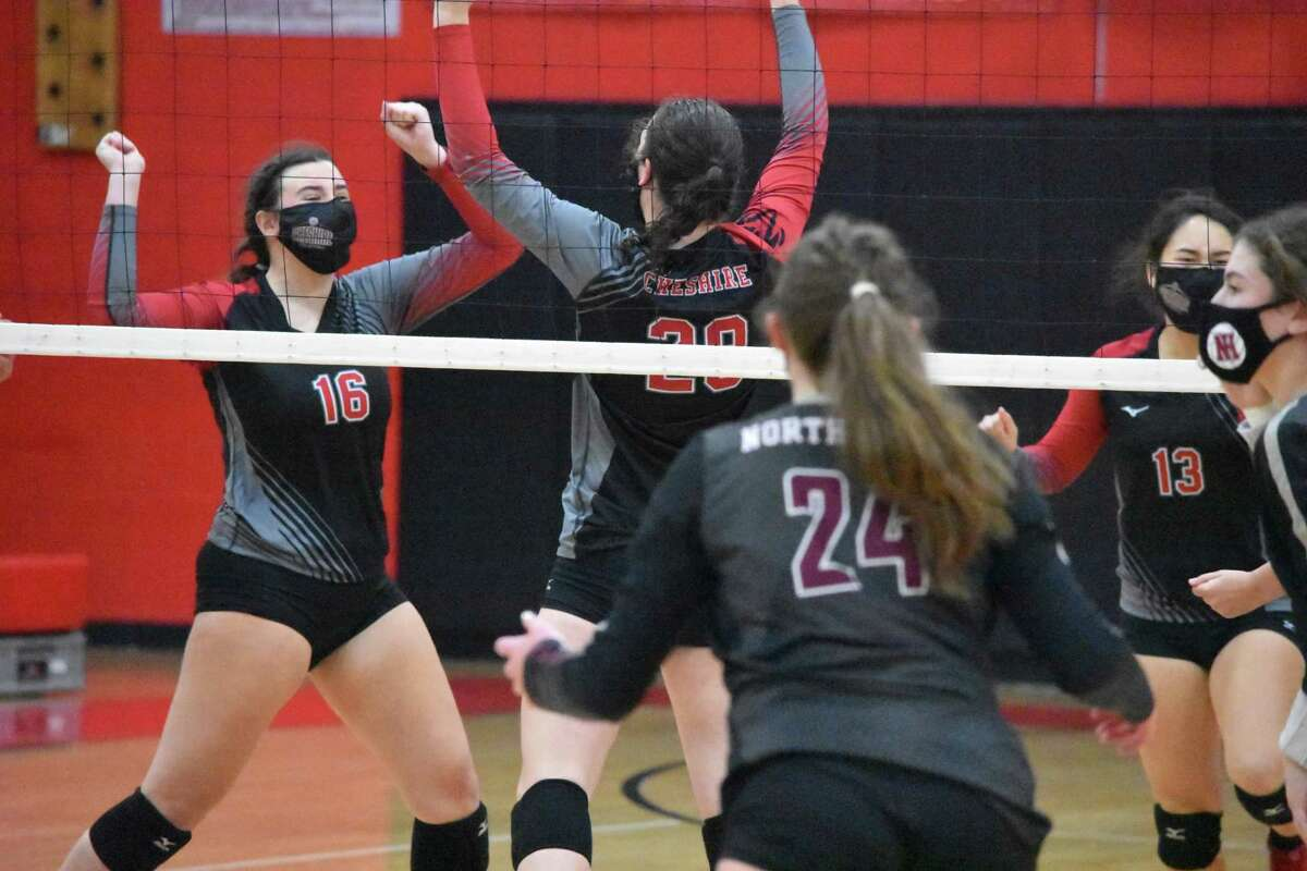 Cheshire's Sarah Holley celebrates after blocking a ball against North Haven in the SCC Division B girls volleyball championship game at Cheshire on Friday.
