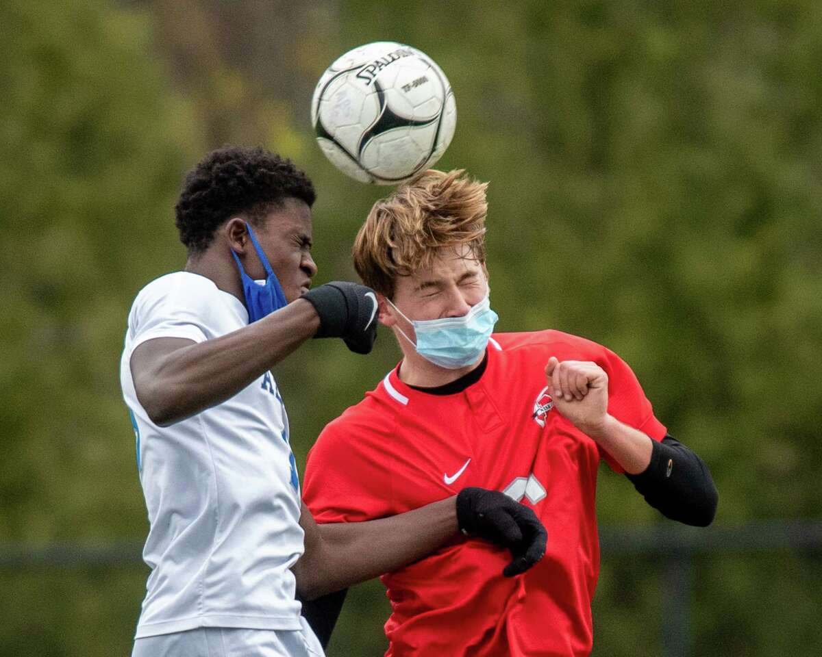 Albany senior Cheick Meite (white) and Niskayuna sophomore Samuel Boyle (red) fight to get a head on the ball during the last Suburban Council game of the regular season at Niskayuna High School in Niskayuna, NY, on Saturday, Nov. 14, 2020 (Jim Franco/special to the Times Union.)
