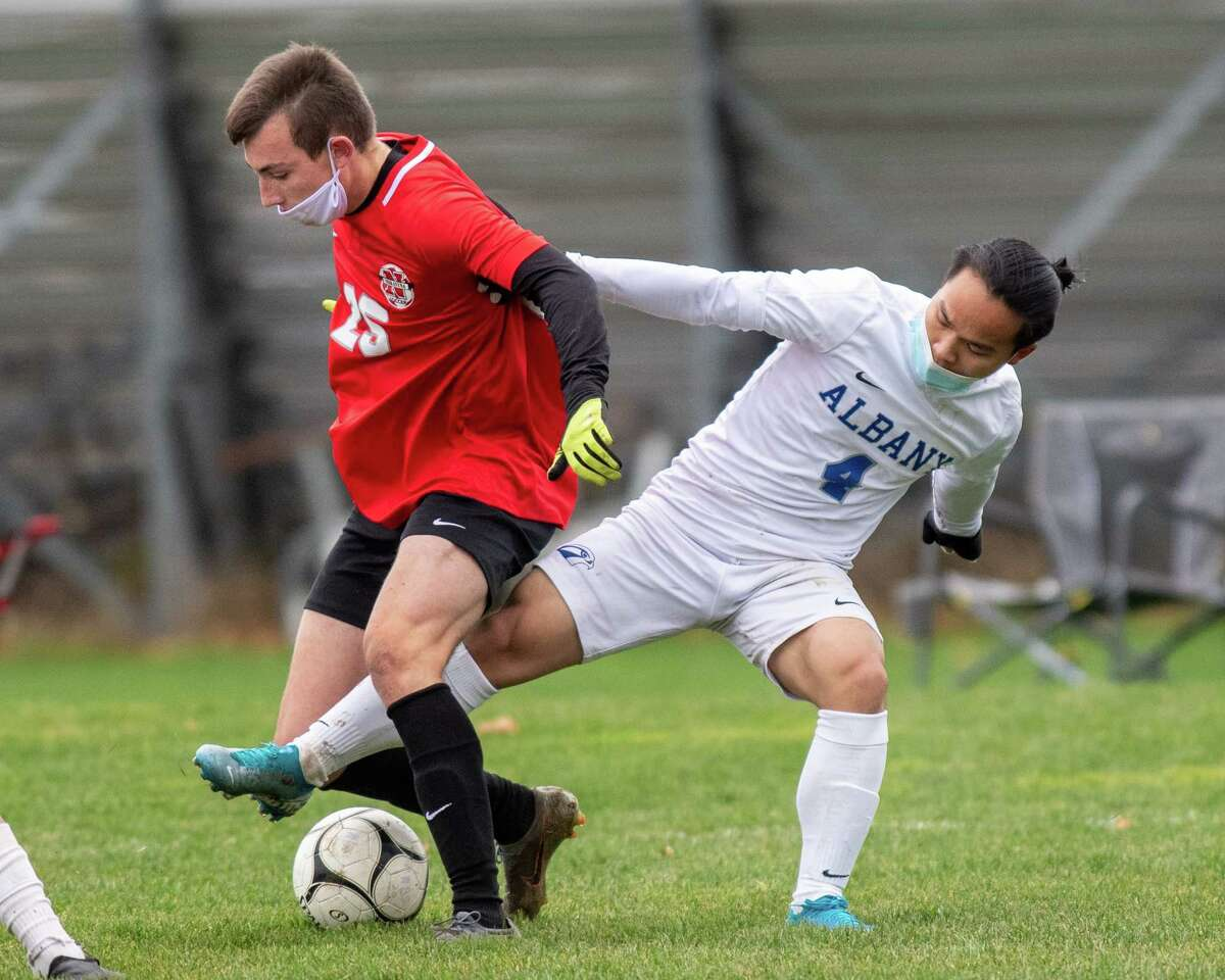 Niskayuna junior Zachary Lind (red) battles with Albany senior Myat Thin (red) during the last Suburban Council game of the regular season at Niskayuna High School in Niskayuna, NY, on Saturday, Nov. 14, 2020 (Jim Franco/special to the Times Union.)
