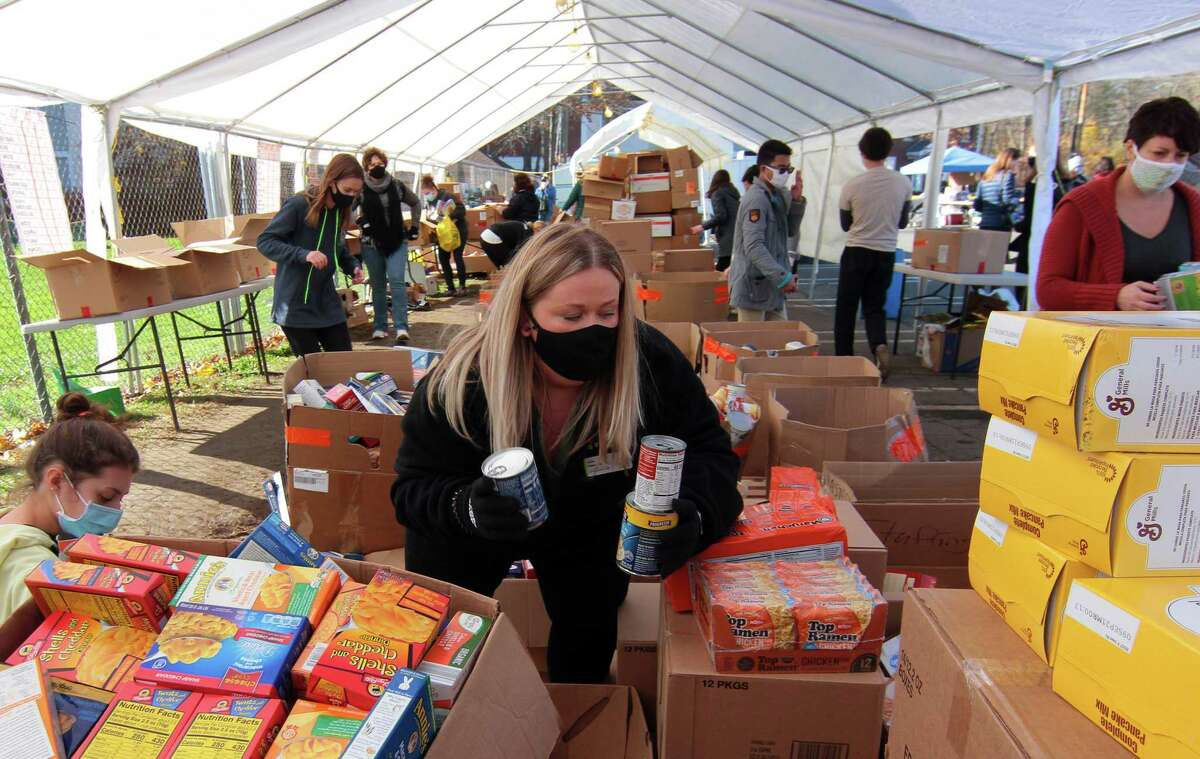 Stop & Shop employee Julie Haesche volunteers to sort food items during the 16th Annual Thanks-for-Giving Food Drive at Wasson Field parking lot in Milford, Conn., on Saturday Nov. 14, 2020. According to the report, some of the most notable fundraisers in Connecticut this past year included a fund to free jailed Black Lives Matter and Trans activist Alexa Wise and a fundraiser for the New Haven Area Mutual Aid Fund. Other major fundraisers included