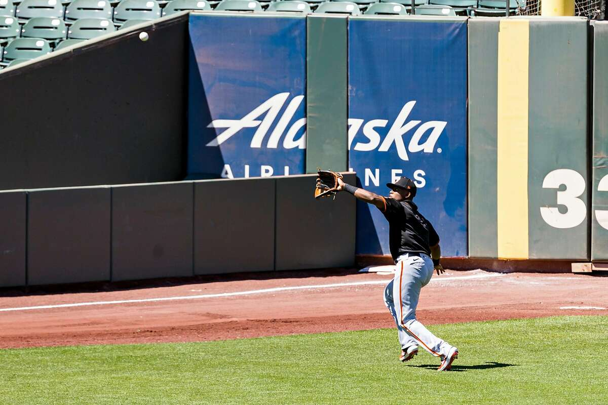 SAN FRANCISCO, CA - JULY 12: San Francisco Giants left fielder Alexander Canario catches a fly ball during the Intrasquad game at Giants training camp on July 12, 2020, at Oracle Park in San Francisco, CA. (Photo by Bob Kupbens/Icon Sportswire via Getty Images)
