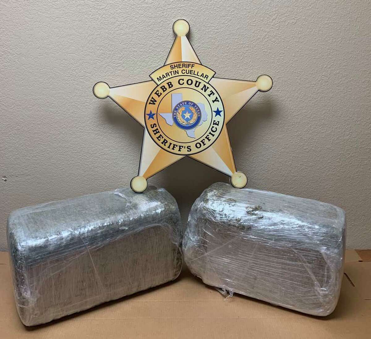 Shown are the two seized bundles of pot weighing 39 pounds which have an estimated street value of $12,000.