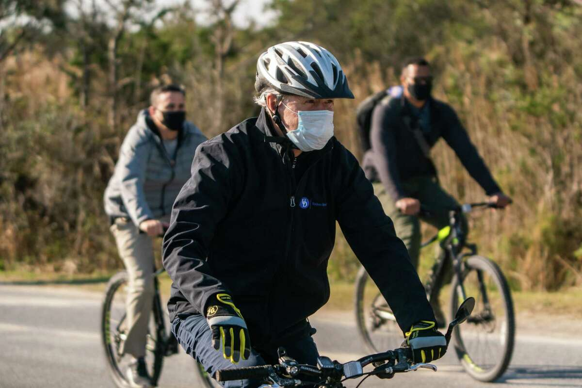 President-elect Joe Biden goes on a bike ride at Cape Henlopen State Park in Lewes, Del., on Saturday Nov. 14, 2020.