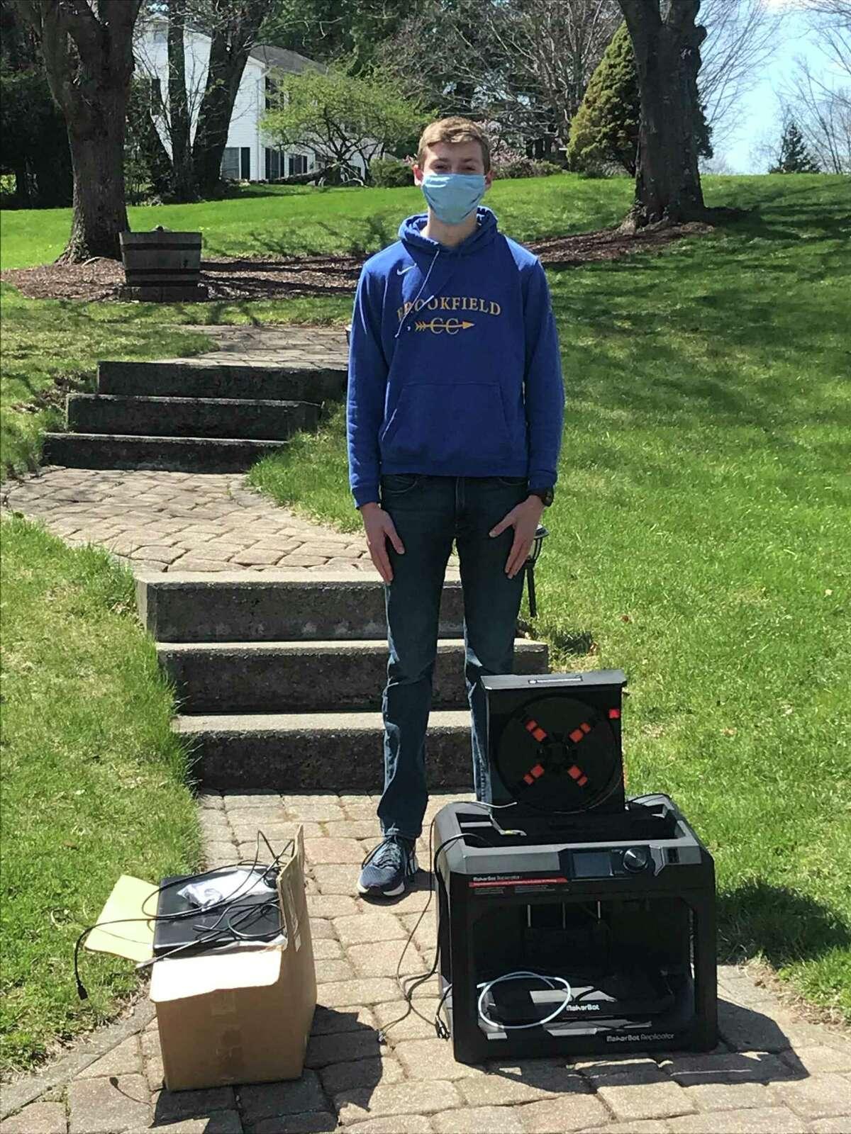 High school senior Logan White with a 3D printer and filament.